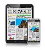 Tablet PC and smartphone with business news Stock Images