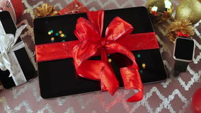 Tablet pc, smartphone and smartwatch for Christmas stock video footage