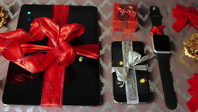 Tablet pc, smartphone and smartwatch for Christmas stock video