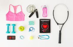 Tablet pc, smartphone and sports stuff Royalty Free Stock Image