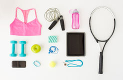 Tablet pc, smartphone and sports stuff Stock Images