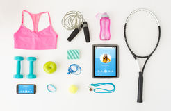 Tablet pc, smartphone and sports stuff Stock Photography