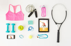 Tablet pc, smartphone and sports stuff Royalty Free Stock Photography