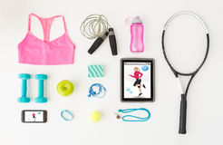 Tablet pc, smartphone and sports stuff Royalty Free Stock Images