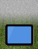 Tablet pc on soccer grass field Royalty Free Stock Photos
