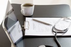 Tablet Pc and Stethoscope on desk Royalty Free Stock Photos