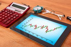 Tablet pc with stock chart Stock Image