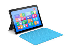 The tablet PC with a surface keyboard. The tablet PC with a surface blue keyboard Stock Photography
