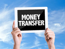 Tablet pc with text Money Transfer with sky background Stock Photo