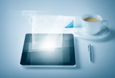 Tablet pc with virtual graph or chart Royalty Free Stock Image
