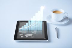 Tablet pc with virtual graph or chart Royalty Free Stock Images