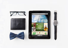 Tablet pc with web applications and personal stuff Royalty Free Stock Photos