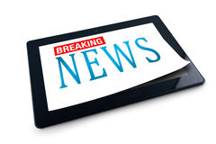 Tablet PC on white background with Breaking News title Royalty Free Stock Image