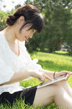 Tablet PC a woman Stock Image