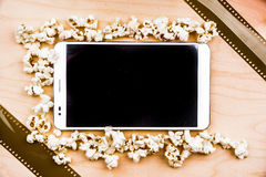 Tablet pc on wood with attributes of cinema. Stock Images