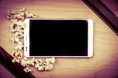 Tablet pc on wood with attributes of cinema. Stock Photography