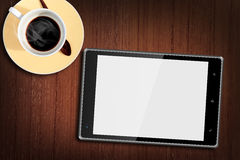 Tablet pc on Wood Table with a cup of coffee Royalty Free Stock Photo