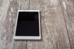 Tablet pc on a wood table Stock Photos