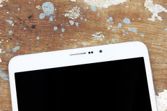 Tablet PC. On wooden background Stock Images