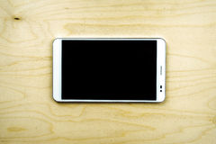 Tablet PC on wooden background Stock Photo
