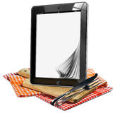 Tablet Pc on the Wooden Cutting Board Royalty Free Stock Photos