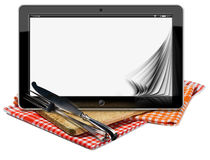 Tablet Pc on the Wooden Cutting Board Royalty Free Stock Image