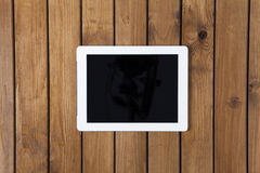Tablet pc on the wooden desk Stock Images