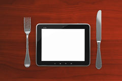 Tablet PC on a wooden table with a blank screen Royalty Free Stock Photography