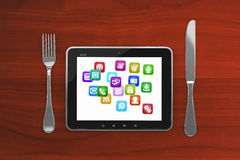 Tablet PC on a wooden table with a blank screen Royalty Free Stock Photos