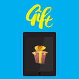 Tablet PC with a yellow gift bow and lettering Royalty Free Stock Photography
