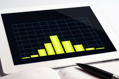 Tablet pc and yellow graph Royalty Free Stock Photography