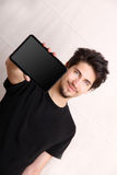 Tablet PC. A young hispanic man holding a Tablet PC Stock Images