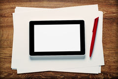 Tablet and pen on blank paper Royalty Free Stock Photo