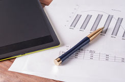 The tablet and pen on the business papers. Stock Images