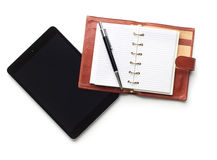 Tablet with pen and notebook Stock Photography