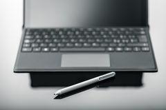 Tablet with pen on shiny surface Stock Images