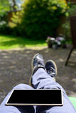 Tablet on persons Legs Stock Images