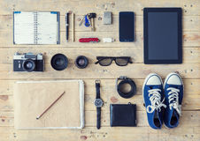 Tablet, phone, album, glasses, camera, lenses, gumshoes and watc Royalty Free Stock Images