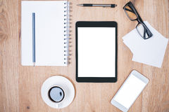 Tablet and phone on desk Royalty Free Stock Photography
