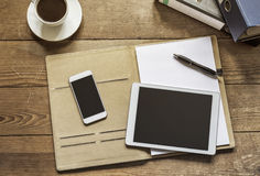 Tablet and Phone on Folder Royalty Free Stock Images