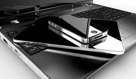 Tablet and phone on a pc. A tablet and a phone on a laptop Royalty Free Stock Photography