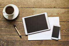 Tablet and phone on wooden workspace Royalty Free Stock Photos