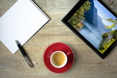 Tablet with picture of lake Königssee with Malerwinkel with not. E pad and ballpint pen Royalty Free Stock Image