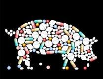 Tablet-Pillen-Schwein Stockfotos