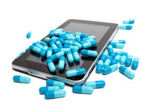 Tablet and pills Stock Images