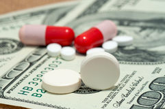 Tablet, pills and dollars Royalty Free Stock Images