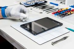 Tablet, pod repair royalty free stock photo