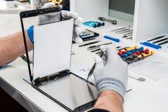 Tablet, pod repair Stock Image