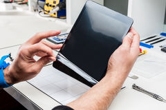 Tablet, pod repair stock photography