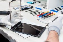 Tablet, pod repair stock photos